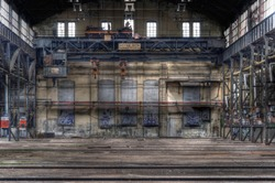 Large abandoned hall with an old crane
