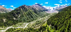 large aerial of engadin mountains/ morteratsch switzerland during summer with trees and mountains in background