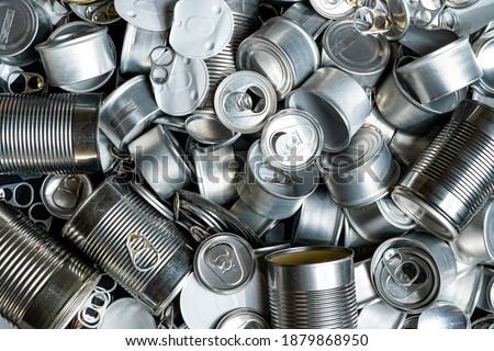 Large amount of metal tins, cans and jars for recycling. Aluminum metal food and drink sorted scraps. Steel packaging. Zero waste and recycle of domestic waste at home concept. No pollution. Stock photo ©