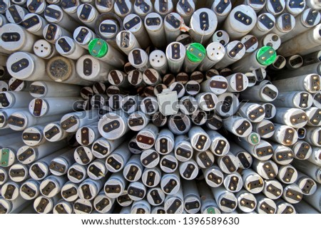 large amount of spent old fluorescent lamp tubes about to be recycled. Waste Disposal concept for old fluorescent lamp tubes. Ecology background or texture concept.
