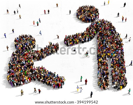Large and diverse group of people seen from above gathered together in the shape of helping gesture