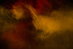 Large and intense red, yellow and orange swirling cloud of smoke in a black background