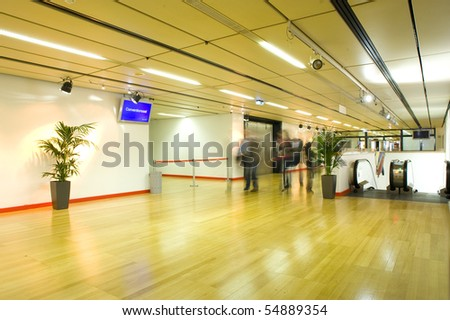 Large and new conference/meeting  hall with blur people in image and a escalator on the side