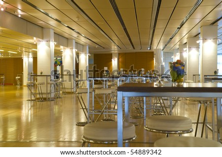 Large and new conference/meeting  room with white stools and tables