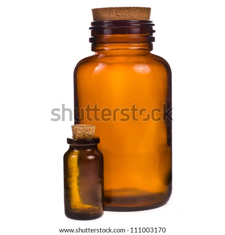 large and small glass medical pot of brown glass with corks isolated on white background