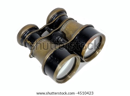 Large antique brass opera glasses (binoculars) isolated on white
