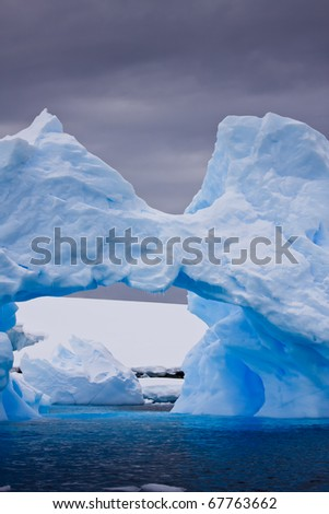 Large Arctic iceberg with a cavity inside