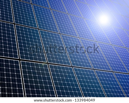 Large array of solar panels with sunlight reflection