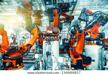 Large automated robotic arm in a car manufacturing plant