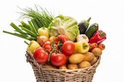 Large basket of vegetables. Potatoes, tomatoes, onions, cabbage, paprika, zucchini, eggplant. Isolate on white background