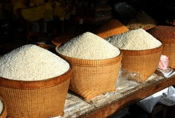 Large baskets of rice in market in Bali