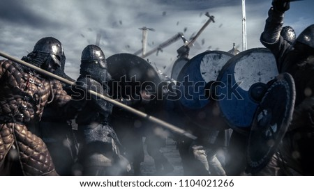 Large Battle Between Medieval Warriors. Medieval Reenactment.