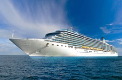 large beautiful cruise ship at sea and nice cloudy sky on background