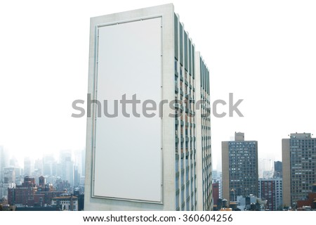 Large billboard on the wall of a building in the background of the city, mock up