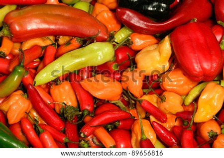 Large bin of spicy peppers at a farmers market