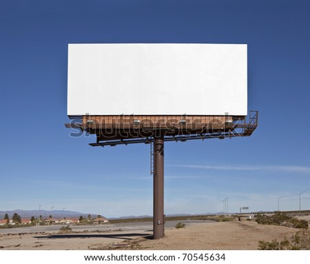 Large blank billboard in the middle of the Mojave Desert.