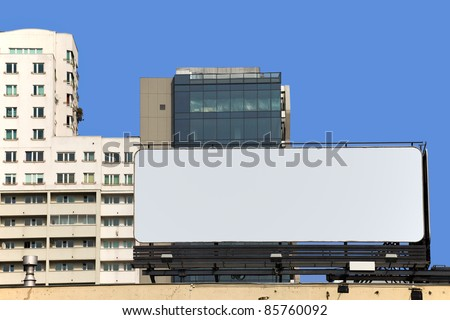 Large blank billboard on a building roof