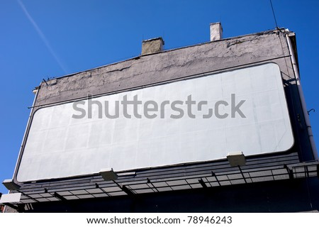 Large blank billboard on a building wall