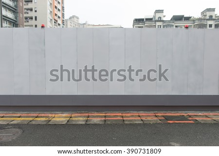 Shutterstock Large blank billboard on a street wall, banners with room to add your own text