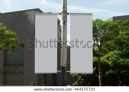 Large blank billboard on a street wall, banners with room to add your own text  #464275721