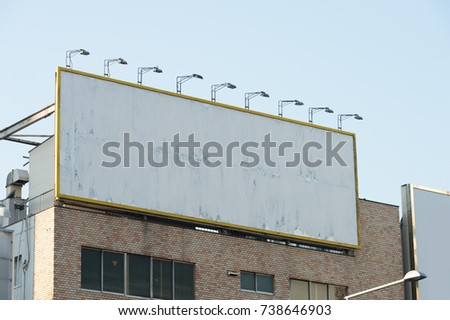 Large blank billboard on a street wall, banners with room to add your own text #738646903