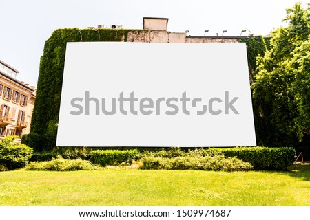 Large blank billboard on building for outdoor advertising in Milano, Italy.