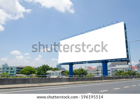 large blank billboard on road with city view background - Shutterstock ID 196195514