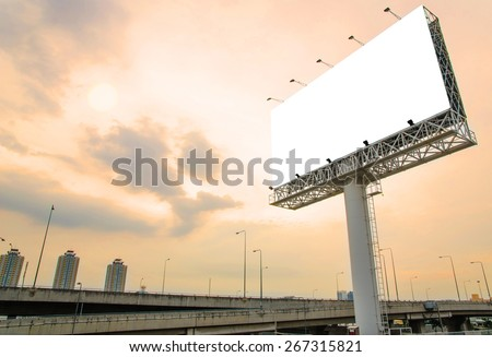 large blank billboard on road with city view background #267315821