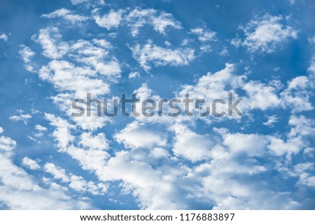 Stock Photo Large blue sky with bigs and smalls white clouds.