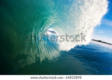 Large Blue Surfing Wave, View into the barrel, a Surfer's Perspective
