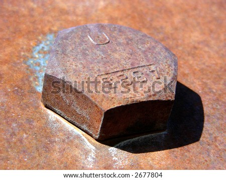 Large bolt head in bridge construction supporting beam
