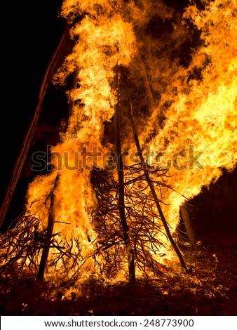 Large bonfire at night. Flames, sparks from celebratory fire