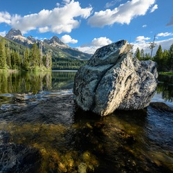 Large Boulder in Taggart Lake with smooth water