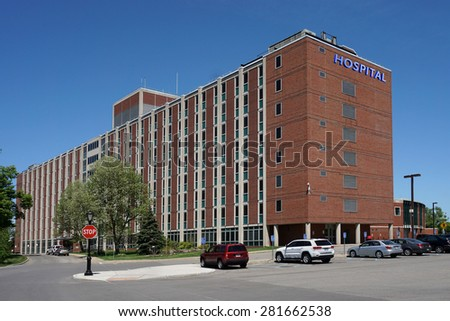large brick building with hospital sign