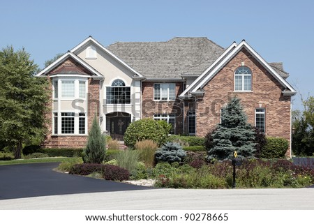 Large brick home with front landscaping