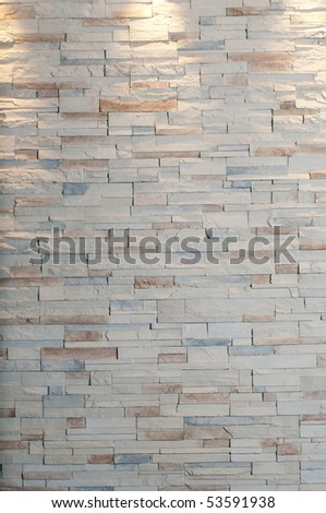Large brick wall with 3 lights at top