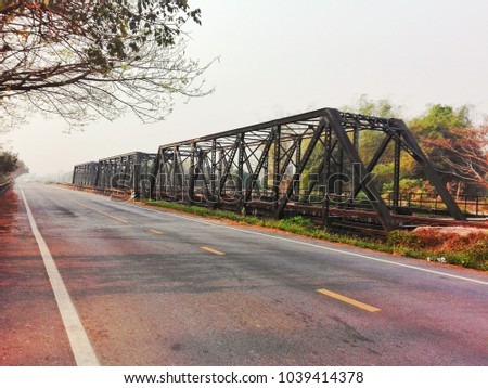 Large bridges are made of strong steel with rust on the surface and structure. Used for trains and vehicles, travel between the outback, freight, fuel and woodland. #1039414378
