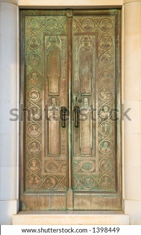 Large bronze doors that mark the entrance of a mausoleum in Cavtat, Croatia.