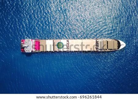 Large bulk carrier ship sailing / docking on open ocean