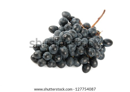 large bunch of dark grapes on a white background