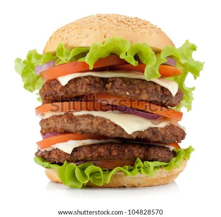 Large burger with beef, cheese, onion and tomatoes. Isolated on white background