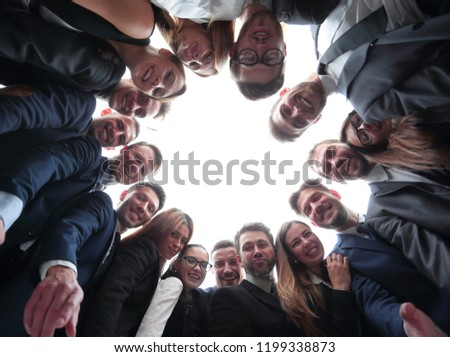 large business team is forming a circle and looking at the camera #1199338873