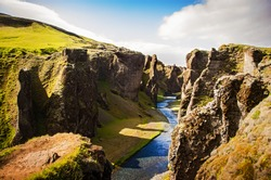 Large canyon with cliffs and a river in Iceland. Fjaorargljufur canyon in Iceland.