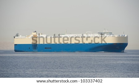 Large car transporter cargo ship under way out at sea
