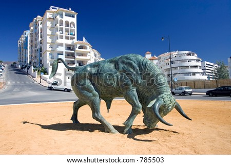 Large cast iron Spanish Bull in center of Roundabout on a sunny day in Estepona southern Spain