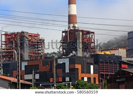 large chimneys in a factory #580560559