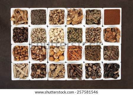 Large chinese herbal medicine selection in white porcelain bowls.