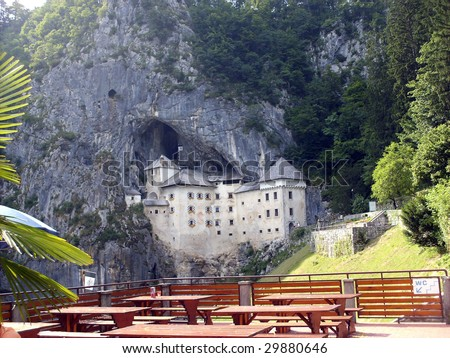 Large church in front of a mountain cave entrance