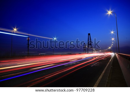 Large city road night scene, night car rainbow light trails