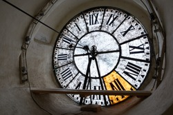 Large clock-face of old mechanical clocks on a tower in a church, inside view.